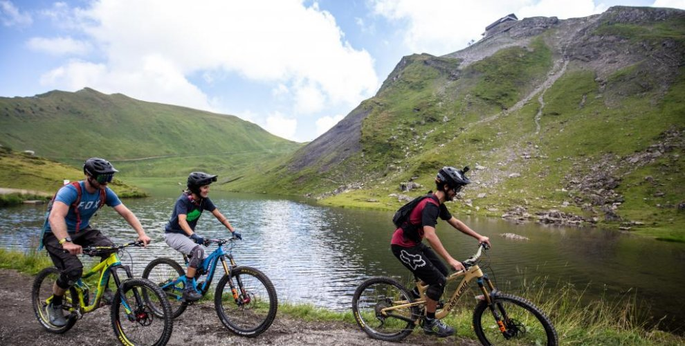 Ride past lakes in the portes du soleil