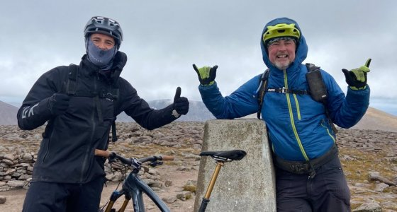 happy mountain bikers in the cairngorms