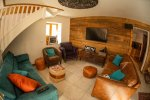 tv lounge area in chalet five25 morzine